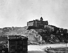 Building Seattle literally meant moving mountains. 1905 The Denny Hotel (later called the Washington Hotel) stands on the south summit of Denny Hill before being torn down.