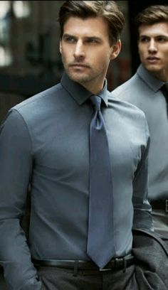 grey shirt and tie