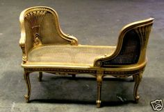 French Gilt Conversational Canapé in Louis XV style, with a pair of cane back rest facing each other, seating for two indiscreetly.  Pierce carving with intricate decorative fan peacock motif backs and caned seating with rams horns scroll and acanthus motif, held by xix cabriole legs ending with scroll feet, so many uses for this versatile piece.