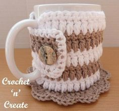 A pretty crochet mug cozy coaster design, 2 patterns in one, a complete cover to keep your hot drinks warm and a pretty coaster to save your tables and desks.I have made it in a soft cotton yarn on a clover crochet hookThis pattern is free to print on Easy Crochet Projects, Crochet Patterns For Beginners, Crochet Ideas, Diy Projects, Crochet Tutorials, Crochet Mug Cozy, Free Crochet, Crochet Coaster, Crochet Hooks