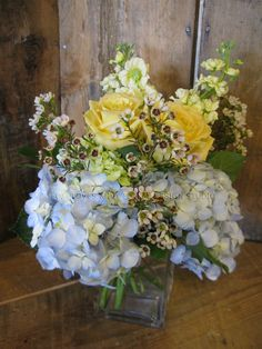 """Centerpiece for 48"""" round table.. soft powder blue hydrangea, butter yellow stock, 'Skyline' roses and waxflower.. delicate yet colorful"""