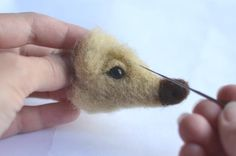 OMG the mother load of felting tutorials Tons and tons here so excited!!!! This is the tiny adorable face of a hedgehog!