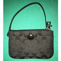 Coach Wristlet in Black Adorable little Coach wristlet! Measures approximately 6.5 inches by 4 inches. Inside is a beautiful shade of baby blue and has two card pockets. Wrist strap is included. Coach Bags Clutches & Wristlets