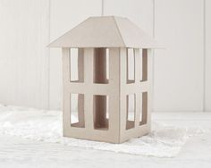 Paper Mache Lantern, U-Decorate A paper mache lantern for you to decorate. This is an old fashioned style rectangular lantern with open windows on all four sides. The plain kraft paper surface works w