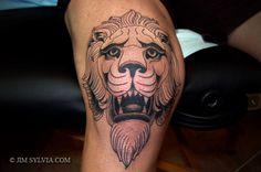 traditional lion knee tattoo