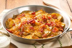 Skillet Potatoes with Bacon and Cheddar recipe - Here's one of our ooey-gooey greatest hits -- cheese-tastic potatoes!! YUM! #skilletrecipes #bacon #cheese