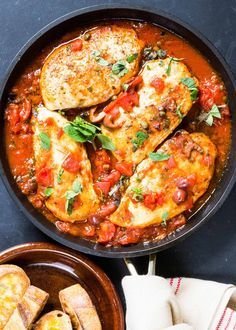 1-Pot, 30 min Skillet Chicken Puttanesca! With chicken breasts, canned tomatoes, olives, capers, anchovies, fresh oregano, and plenty of olive oil. Dairy-free, gluten-free, paleo