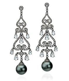 A pair of conch pearl and diamond earrings The articulated ...