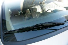 Change your wiper blades - Once a year at least. To replace, proper up  wiper stopper, unhook the blade and slide it off the arm, then slide in the new blade ($15 each at auto parts store). Swivel the wiper arm until the blade clicks in place, then set the wiper back on the glass.