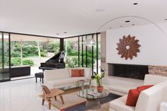 Custom home in Texas. 90-degree multi-slide door floods this mid-century modern living room with light.