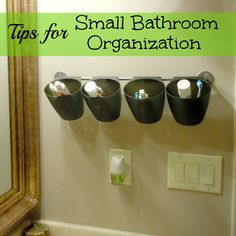 Hang hanging baskets from a towel rod for bathroom organization. Could totally work with make up products too!
