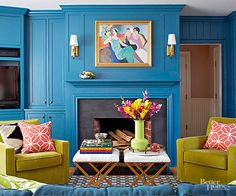 Brilliant blue paint firmly connects the different components in this eclectic living room.