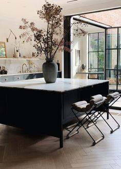 black and white kitchen design, large black kitchen island with bar stools, modern kitchen decor Home Interior, Interior Design Kitchen, Interior Architecture, Interior Decorating, Kitchen Designs, Decorating Ideas, Decorating Websites, Modern Interior, Interior Livingroom