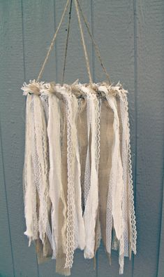 burlap and lace fabric hanging decor | 50 Best Burlap Wedding Ideas | via http://emmalinebride.com/decor/burlap-wedding-ideas/