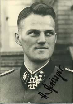 """Caption: """"Heinrich Springer (November 3, 1914 – October 27, 2007) in his formal portrait on the award of the Ritterkreuz des Eisernen Kreuzes (Knight's Cross of the Iron Cross), January 1942. Unlike many """"Aces"""" who won this award by accumulating a """"score"""", Springer earned his for a single infantry combat action where he displayed exemplary personal bravery, leading a charge on a heavily defended bridge over the river Don. He was a Hauptsturmführer (Captain) in the 1. SS-Division…"""