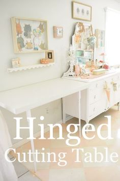Hinged cutting table with fold up legs!  Wonder full idea!