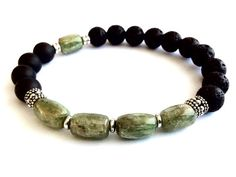 This unisex bracelet is made with amazing green Kyanite cylinder stones which are of a beautiful colour....soft but vibrate. I have combined it with matte Onyx and Lava Rock. The metal used is pewter spacers which are lead and nickel free and Sterling silver cylinder beads anchoring the Kyanite stones.