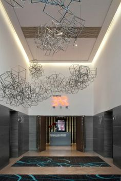 Learn more about Luxxu's pieces at  luxxu.net and discover the best hotel reception and lobby lighting decor for your new hotel project! Luxury and still modern lighting and furniture
