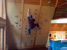 Home wall - living room by Elevate Climbing Walls