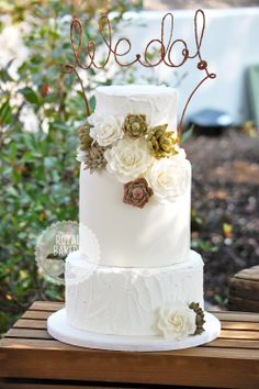"""Roses and succulents wedding cake - 9"""", 7"""" one-and-a-half height barrel and 5"""" cake. Top and bottom tiers are iced in rustic royal icing as the wedding was outdoors and the forecast was for high 90s temperatures!   The roses and succulent arrangement was based on one by My Sweet and Saucy."""