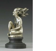 A fine and rare 'Femme au vent' mascot by Guiraud Rivière, French, circa 1925,