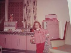 My favorite Christmas, 1964.  My favorite gift of all time, my pink kitchen.  See the ad for it above.