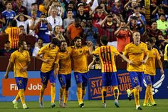 Luis Suarez #9 of Barcelona celebrates with teammates after scoring against Chelsea in the second half during the International Champions Cup North America at FedExField on July 28, 2015 in Landover, Maryland. Chelsea won in a penalty shootout.
