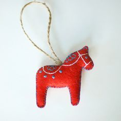 dala horse ornament reminds me of an embroidered rocking horse in my collection