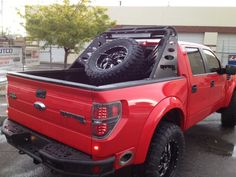 This is my kind of raptor, side exhaust and rack that triples as shock linkage, light bar, and spare tire holder