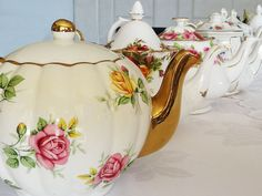 Teapots of mixed styles and colours all for hire. www.highteahire.co.nz