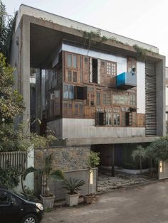 Taking inspiration from Mumbai's informal settlements, S+PS Architects designed a private house on the hills using found objects and recicled elements in a very native collage.