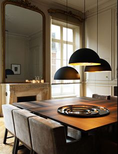square dining tables are my absolute favorite shape  Black pendants hung at different heights, I would even put a bench (or two) for more seating  Wood