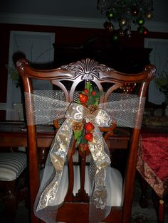 1000 images about christmas holiday tables chairs on for Christmas decorating ideas for dining room chairs