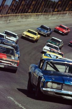 1971 Miller High Life 500 at Ontario Motor Speedway. NASCAR Winston Cup Series. Looks like David Pearson's #17 Mercury up front. It's hard to tell from this shot. He usually ran his numbers on the headlight covers. That's Pedro Rodriguez's #25 red/black Plymouth on the left.