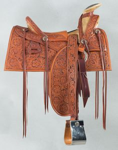 A finely tooled Mexican Mountain Saddle with sterling silver accents by Santa Fe craftsman, Clint Mortenson. Brian Lebel's Old West Auction, June 11, 2016. Est. $5,000-8,000.