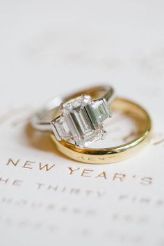 three stone art deco engagement ring with gold men's wedding band  | Photography: Michelle Beller