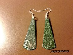 Earrings made of green fimo and silver sheets.