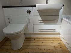 Fitted furniture with a semi recess basin, 2 full extension drawers and our patented toilet unit. This unit provides easy access to the cistern & additional storage for toilet brushes, loo rolls or bleach bottles.