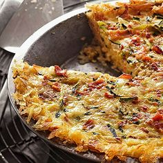 Hash Brown Quiche Recipe with russet potatoes, salt, ground black pepper, olive oil, butter, sausage, asparagus, shredded zucchini, onion, eggs, light cream, crushed red pepper, and shredded cheese