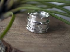 Personalized, hand stamped spinner ring, worry ring, fidget ring made from recycled sterling silver. A ring that can help ground you and bring you back to the moment. Golden Jewelry, Sterling Silver Jewelry, Silver Jewellery, Meditation Rings, Name Rings, Dreamland Jewelry, Spinner Rings, Bridal Jewelry Sets, Statement Rings