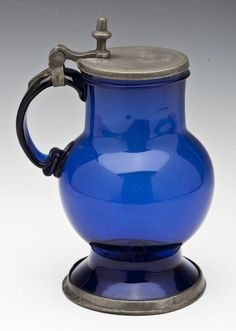 """19th century cobalt handblown glass stein with a pewter rimmed base, lid, and thumb lift. Lid marked """"G.K. 1853."""" 8-3/4"""" high."""