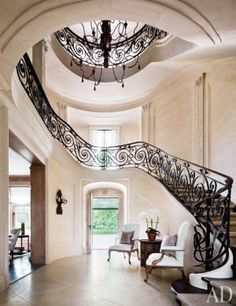 Foyer and stairs, interior design ideas and home decor ~ Renovation of Villa Maria, in Water Mill, NY, by architect Andre Tchelistcheff and designer Carol Egan. Architectural Digest, Architectural Features, Grand Staircase, Staircase Design, Stairs, Spiral Staircase, Black Staircase, Wrought Iron Staircase, Grand Foyer