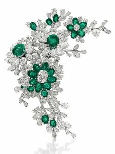 This Bulgari brooch of emeralds and diamonds was an engagement gift from Burton. Taylor wore it with the yellow dress at their wedding. (via Flavorwire)