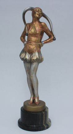 circa 1920's,   depicting a laughing female jester,  with a silvered, gold and copper cold-painted finish,  mounted on a marble plinth-  32.5cm / 12.5 in high  signed Lorenzl in the bronze socle.  This stunning bronze has wonderful styling which is very similar to Lorenzl's work for Goldscheider with there being a possibility this was also produced in a ceramic version.  The cold-painted bronze is in great condition with very slight wear to the metallic finish and minor chipping to the…
