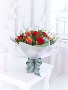 A medley of spring flowers create this seasonal vase arrangement introducing the autumn country living flower bouquets with interflora mightylinksfo
