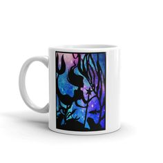 This listing is for an mug with a print of my swimming mermaid papercut.  Magic and mystery make fantastic art pieces and this brings my love of galaxy art into my love of nature to create a truly unique one of a kind design.  - Ceramic - Dishwasher safe - Microwave safe - Available in 11 oz and 15 oz sizes - White, glossy  This sturdy white, glossy ceramic mug is an essential to your cupboard. Looking for the perfect amount of your hot beverage without refills? Search no more. This brawny…