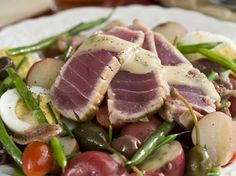 Salad nicoise, a bistro classic, gets revamped with seared ahi tuna. Homemade Dijon vinaigrette (used as dressing and to flavor the tuna) adds huge flavor.