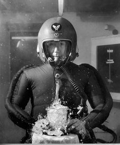 In a pressurised chamber simulating an altitude of 65,000 ft - causing a beaker of water to boil. without protection, humans would suffer a similar effect.  1953