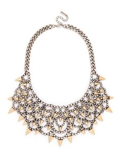 A silver scalloped bib coated in pavé crystals toughens up with short gold spikes for a fierce, mixed-metal effect with high-wattage shine.