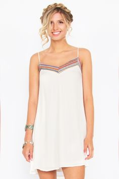 Quality made in the USA!! Cream Shift Dress with Spaghetti Straps and ethnic trim and cutouts on the back! We ship worldwide! Several low-cost shipping options. Made from 100% rayon giving it a silky feel and appearance, yet breathable like cotton. Comes with full polyester lining Purchase for only-$40.00 via PayPal at our eBay store at: www.ebay.stores.com/theofferbazaar. Also buy from our SSL Encrypted web-store at:  www.shopdirectonline.net.